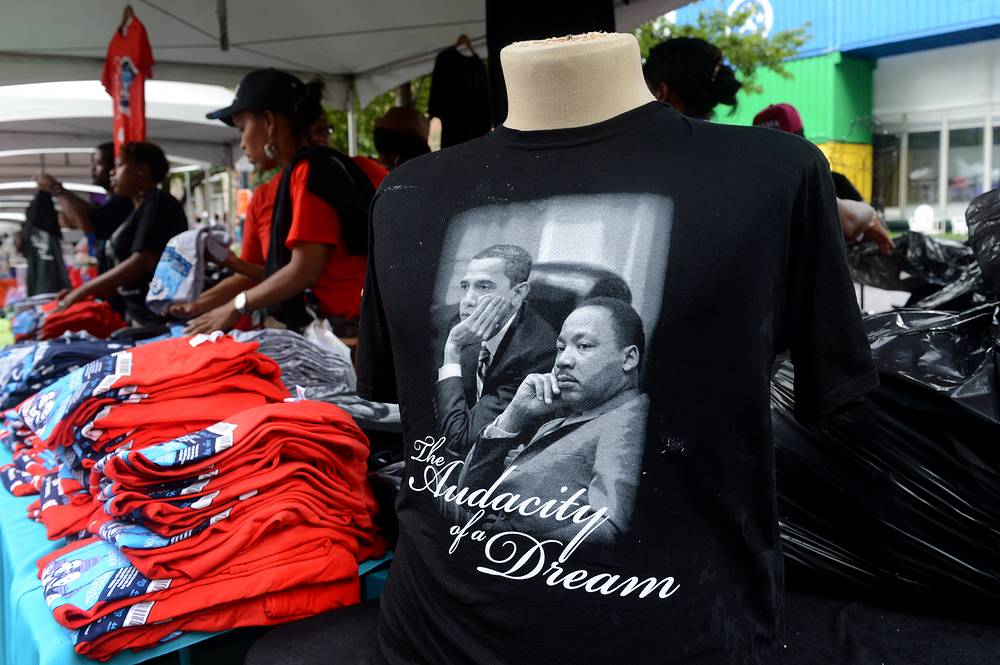 A t-shirt that depicts US President Barack Obama sitting beside Dr. Martin Luther King, Jr.