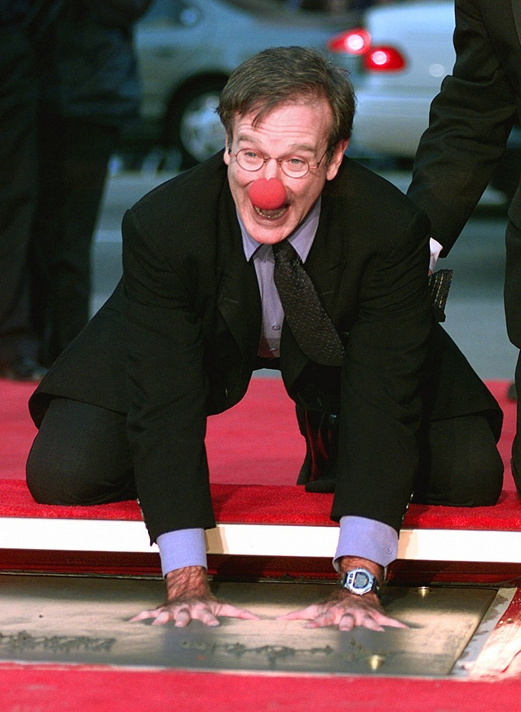 Williams wears a red nose which he wore in his new movie 'Patch Adams' while dipping his hands in wet cement at the Mann's Chinese Theatre in the Hollywood area of Los Angeles in 1998