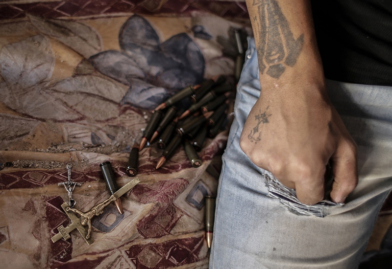 A militant renews his ammunition in the Syrian town of Maalula, 2013