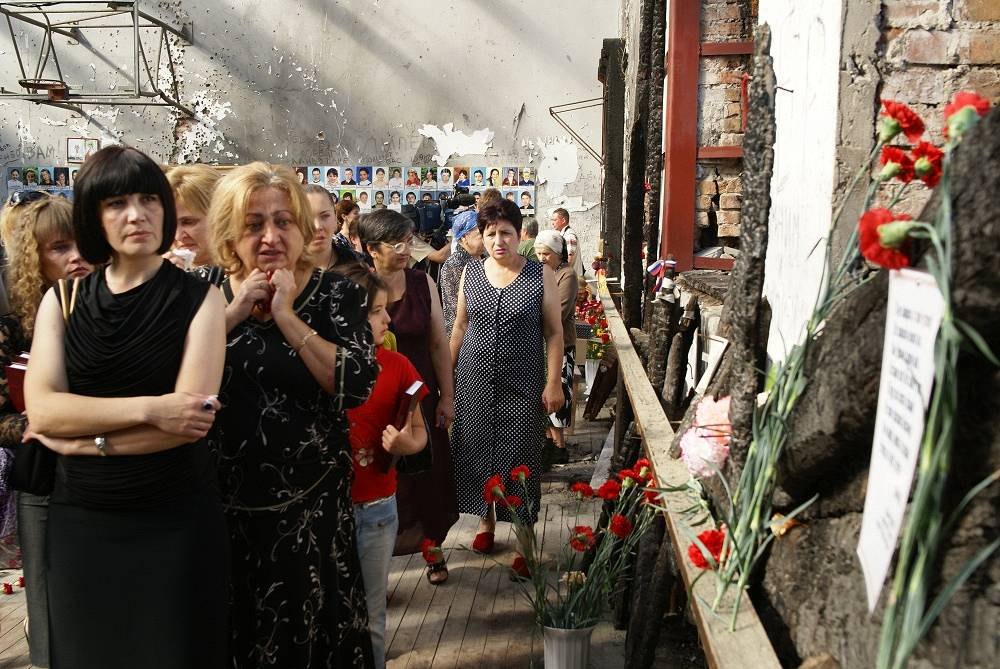 Relatives of the victims and other people honoring the memory of the victims on September 1, 2009