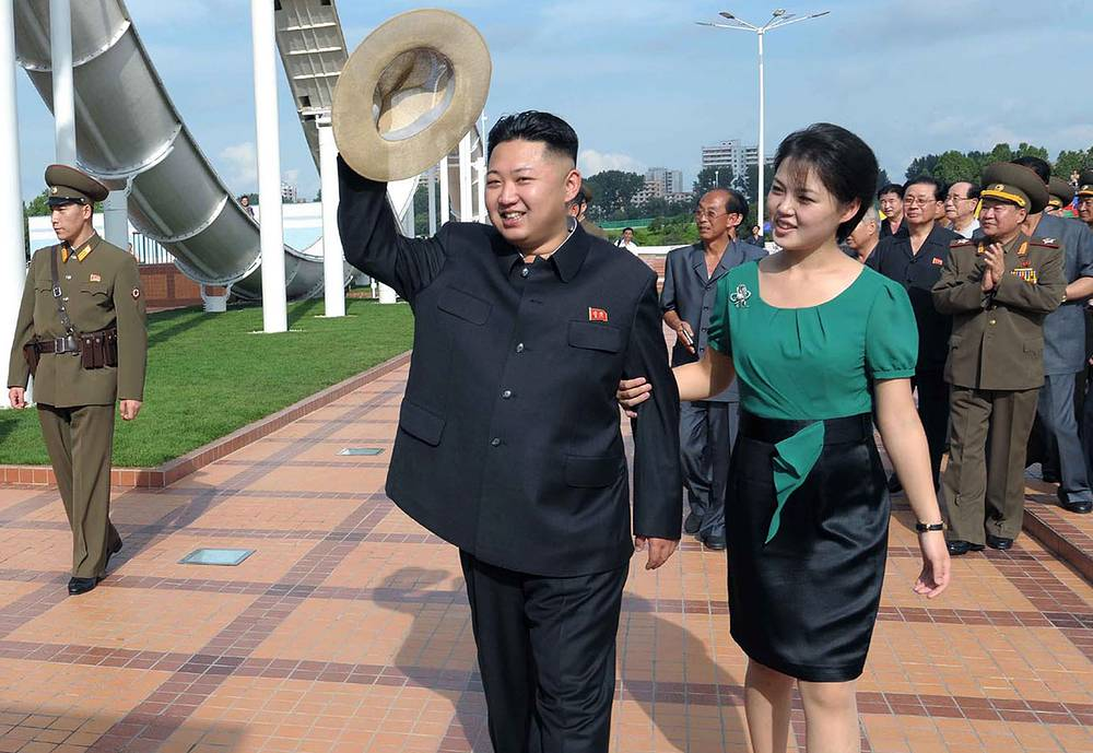 Photo: Kim Jong Un, accompanied by his wife Ri Sol Ju, inspects the Rungna People's Pleasure Ground in Pyongyang, file photo released July 25, 2012