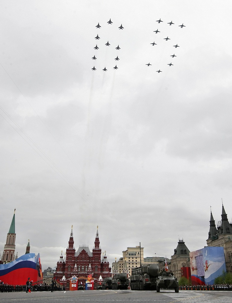 Photo: Aerobatic teams fly above the Red Square forming the number 65 during the general rehearsal of the Victory Day parade in Moscow, 2010