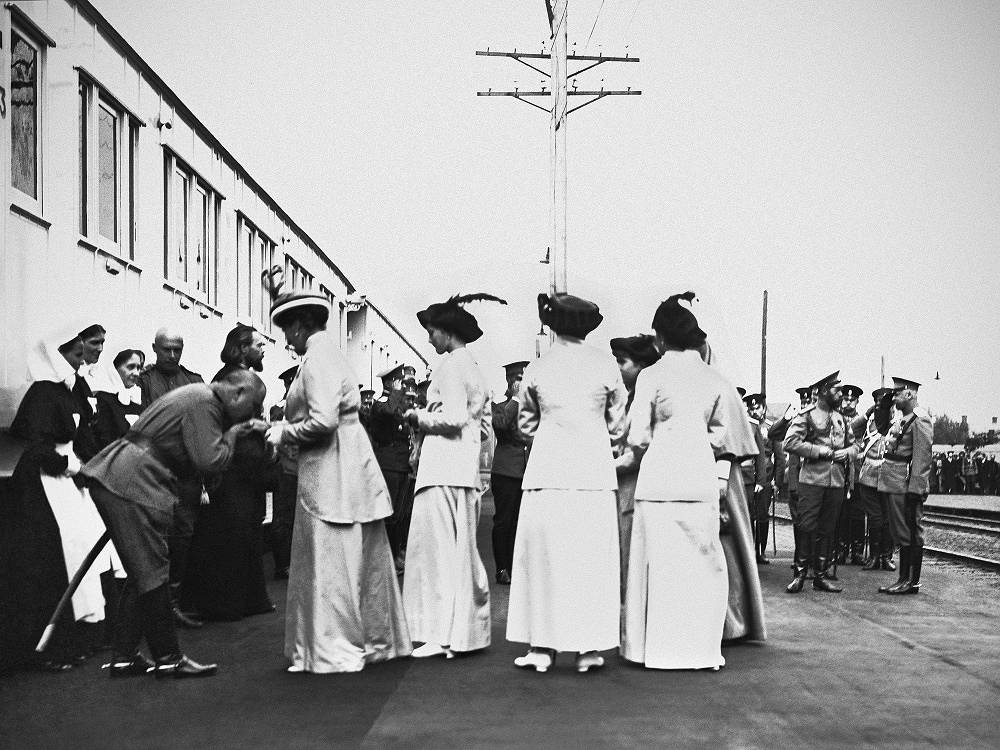 Emperor of Russia, Nicholas II with his wife Alexandra Feodorovna and Grand Duchesses near the ambulance train at the Kazan station in Moscow, 1914