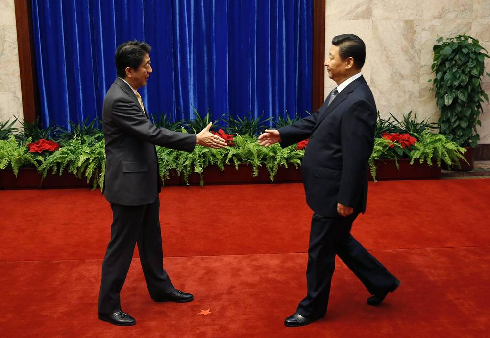 APEC summit in Beijing was marked with Japanese Prime Minister Shinzo Abe and Chinese President Xi Jinping holding their first meeting over the past two years
