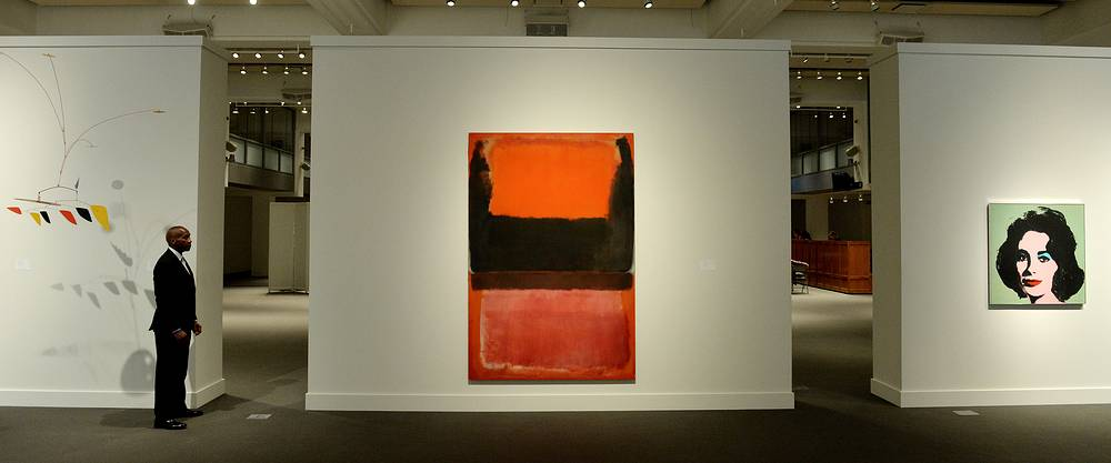 "Mark Rothko painting No. 21 (Red, Brown, Black and Orange, pictured centre) was sold at Sotheby's auction in New York for $45 million on November 11. Another highlight was Jasper Johns' ""Flag."" It brought in $36 million, a record for the artist's work at auction. Andy Warhol's portrait of Elizabeth Taylor (right) fetched $31.5 million"
