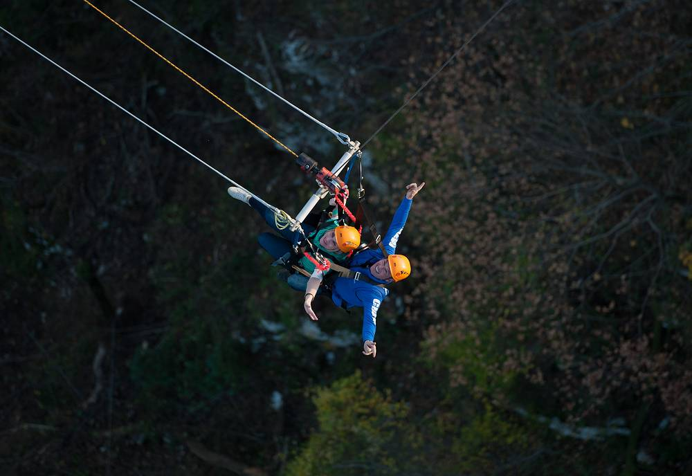 Photo: Alan John Hackett, a New Zealand entrepreneur who organised the first commercial bungee jumping    rides a rope swing over the gorge of the Mzymta River, at Skypark