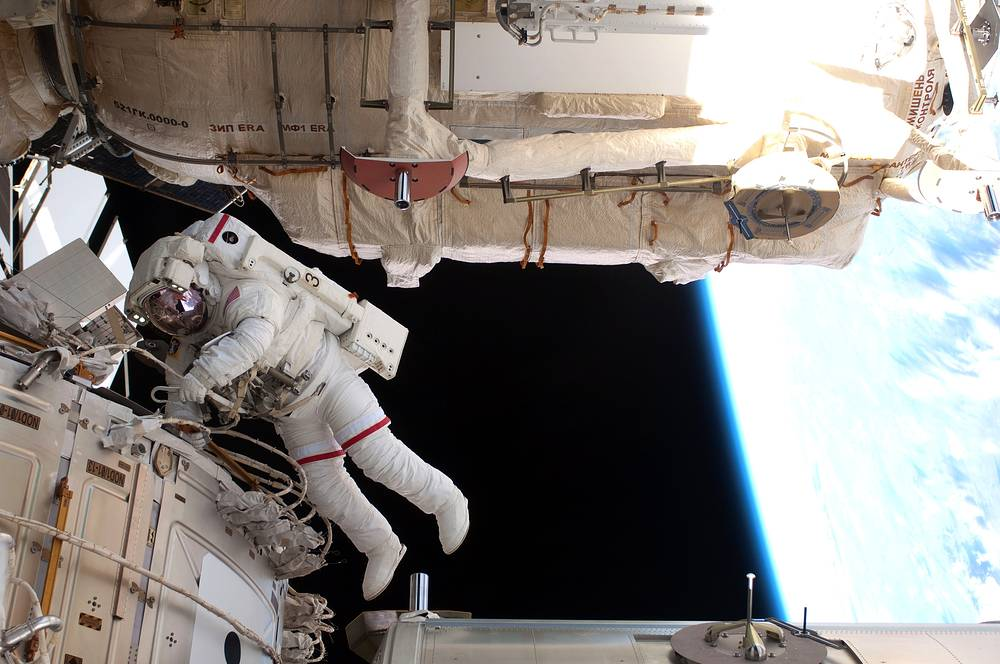 The station serves as research laboratory in which crew members conduct experiments in biology, physics, astronomy, meteorology and other fields. Photo: NASA astronaut during the spacewalk, 2011