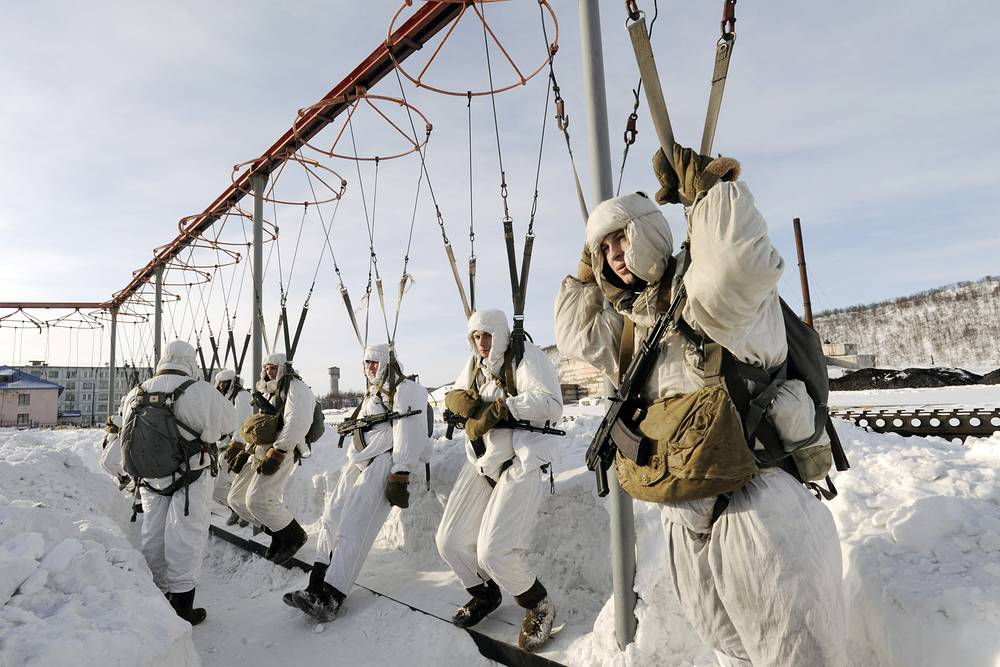 Photo: Marines in snow camouflage take part in parachute training during a military exercise by Russia's Northern Fleet