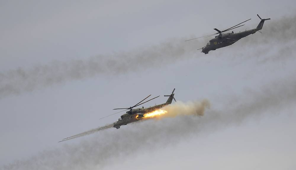 Mi-24 can be tasked with close air support, anti-tank operations or aerial combat. Photo: Mi-24 helicopters fire missiles during a large-scale military drill by the Russian Air Force and Air Defense