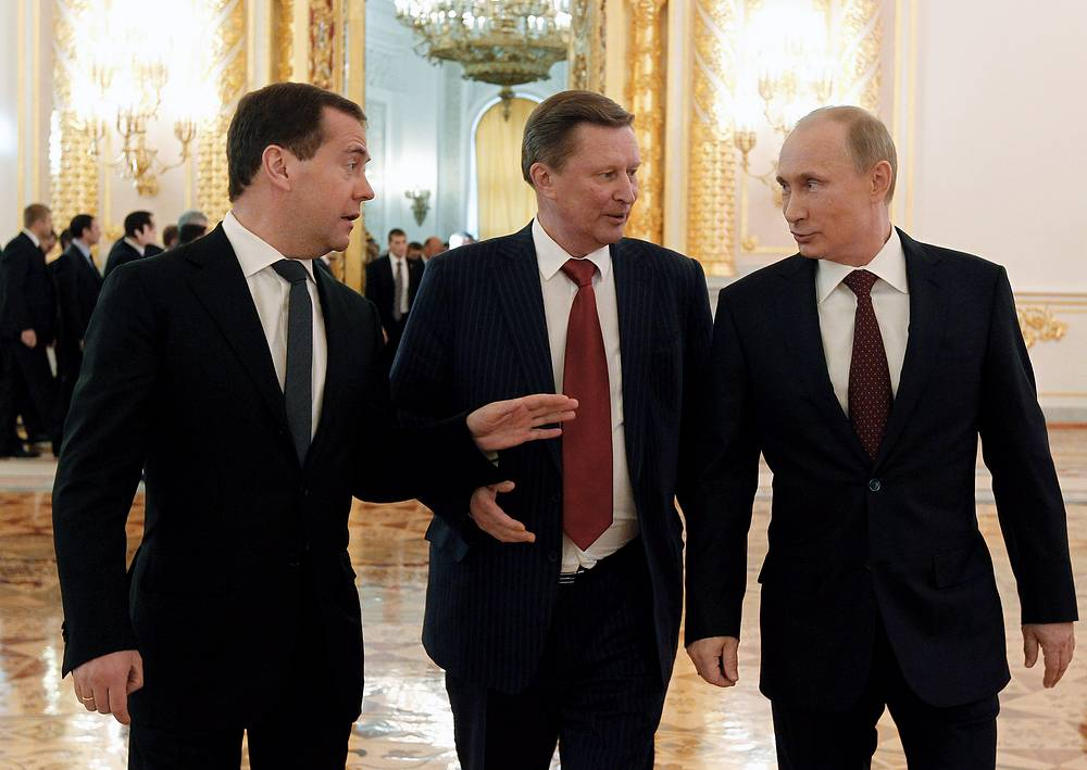 Prime Minister Dmitry Medvedev, presidential chief of staff Sergei Ivanov and President Vladimir Putin talking after the state-of-the-nation address. December 12, 2012