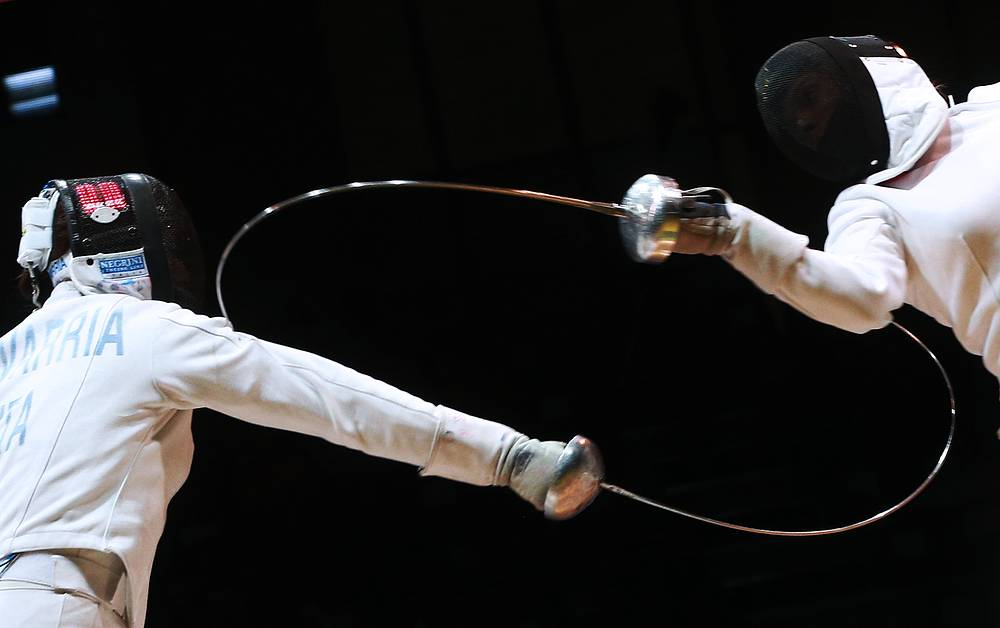 Italy's Mara Navarria (left) and Hungary's Hajnalka Toth compete at the 2014 Fencing World Championships, at Basket-Hall Arena in Kazan