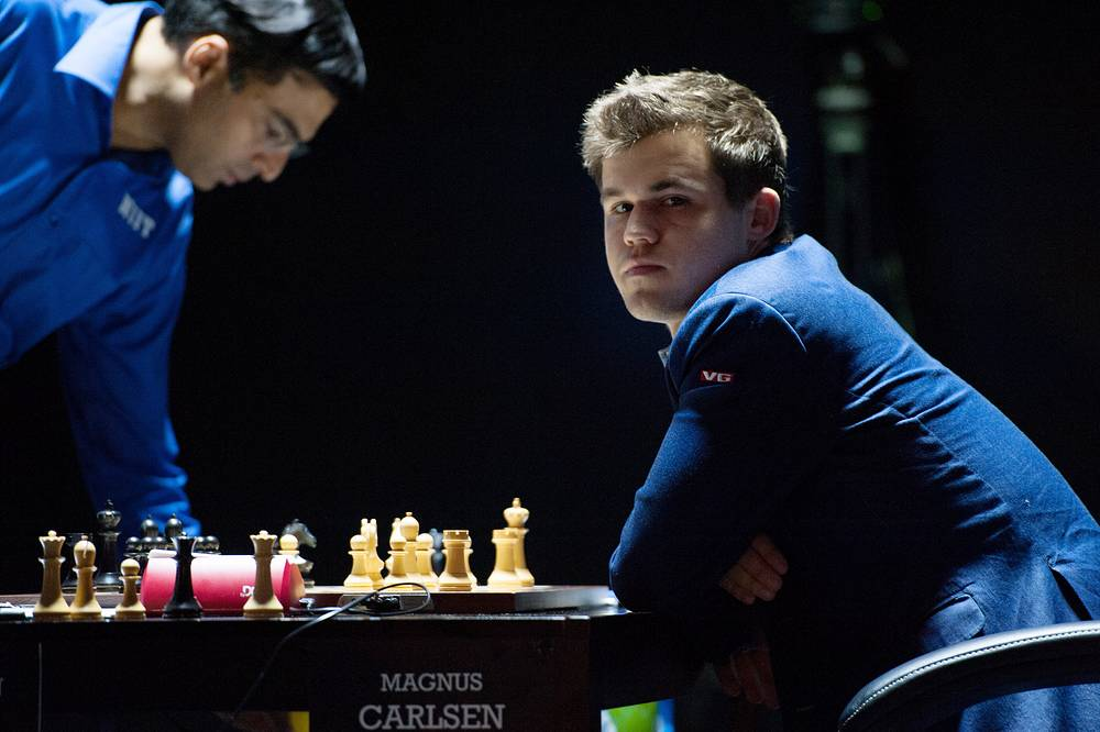 Grand masters Viswanathan Anand of India (left) and Magnus Carlsen of Norway play a round of the 2014 World Chess Championsip in Sochi