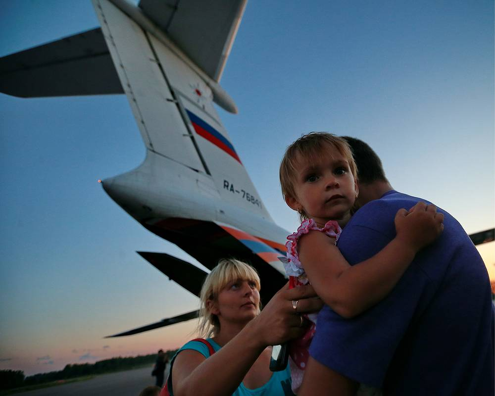 Ukrainian refugees at an airport in Russia's Ivanovo Region