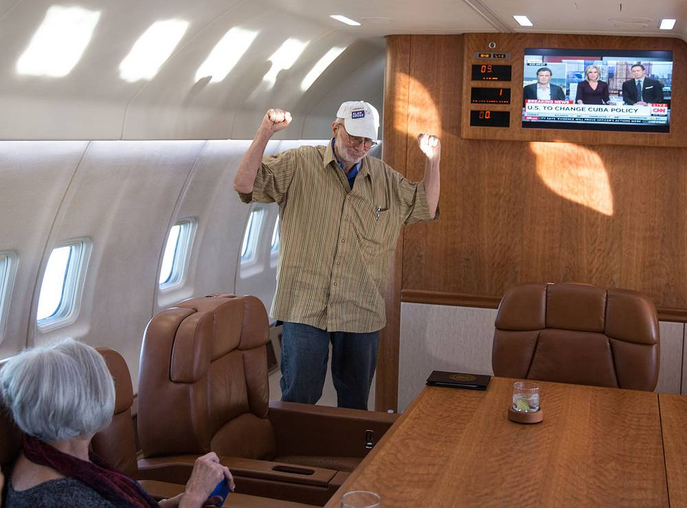 American Alan Gross was released from Cuba after five years in a Cuban prison. Photo: Gross onboard a government plane headed back to the US with his wife