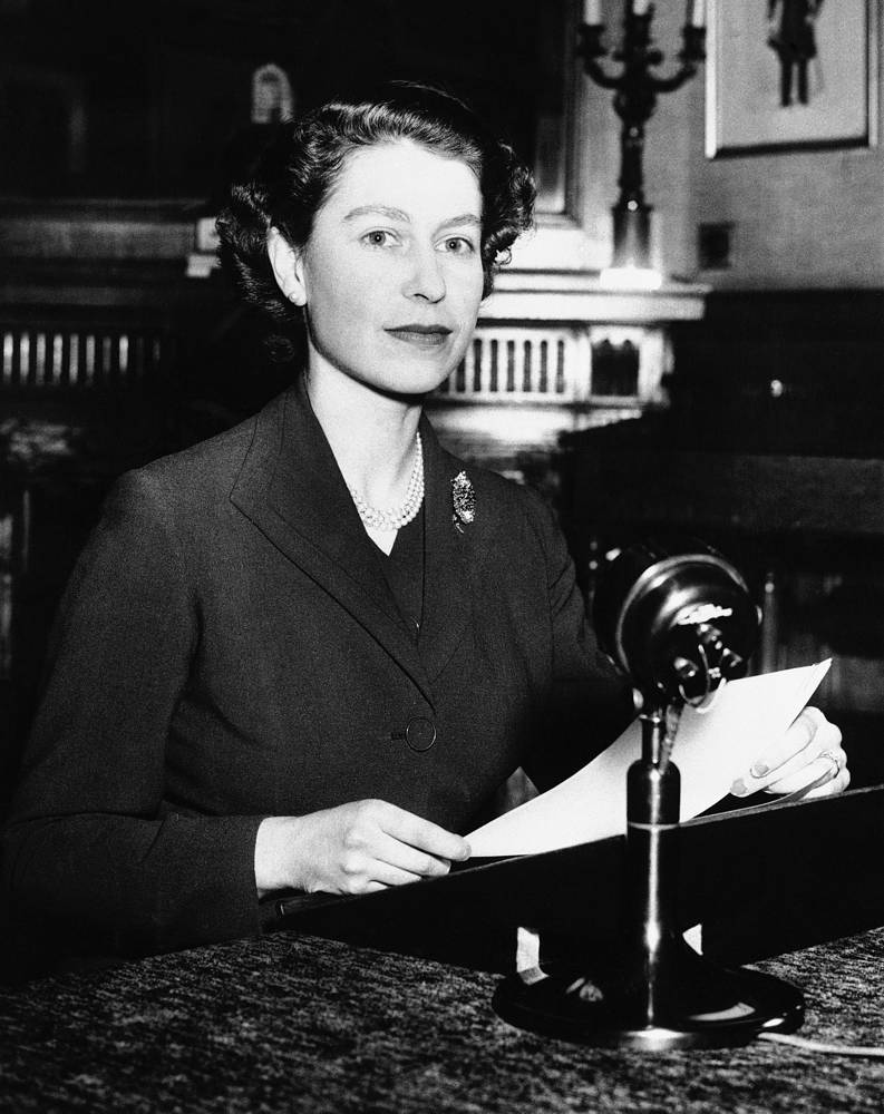 By 1957, the broadcast became televised. Photo: Queen Elizabeth II sits at microphone at Sandringham House as she delivers her first Christmas message to her people, 1952. The Royal Christmas broadcast followed a tradition set by the Queen's grandfather, George V, and continued by her father the late George VI