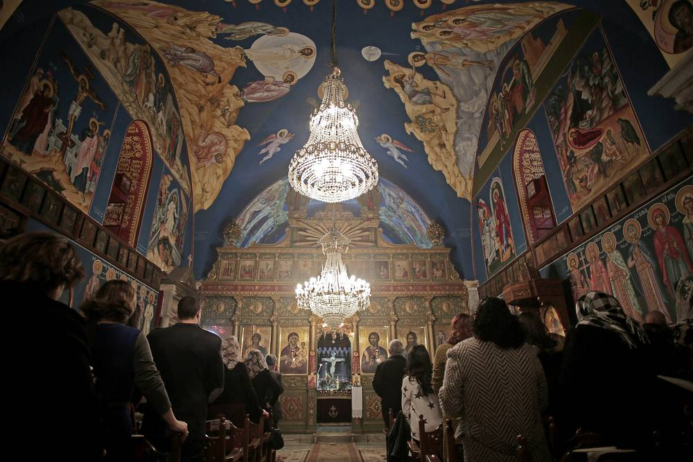 Palestinian Christian Greek Orthodox worshippers celebrate Christmas mass at St. Porphyrios Church in Gaza City