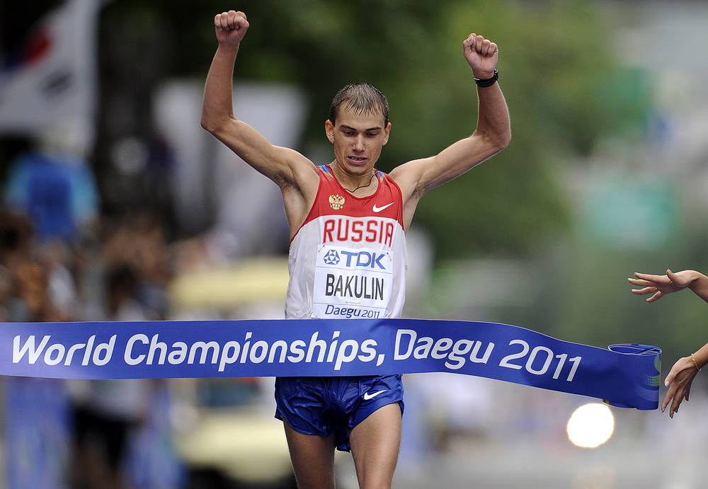 2011 world champion Sergei Bakulin was also disqualified after he was found guilty of violating anti-doping regulations. Photo: Sergey Bakulin of Russia crosses the finish line to win the men 50km Walk in Daegu during the 13th IAAF World Championships in Republic of Korea, 2011