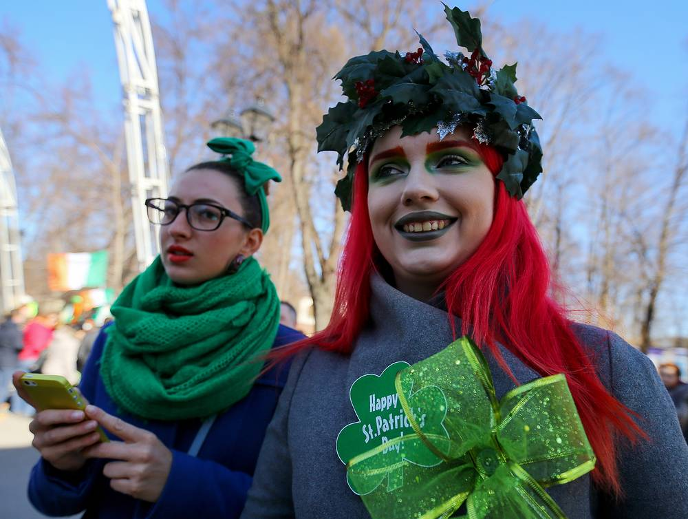 Participants wearing traditional Irish green colour taking part in a parade celebrating Saint Patrick's Day in Moscow's Sokolniki park