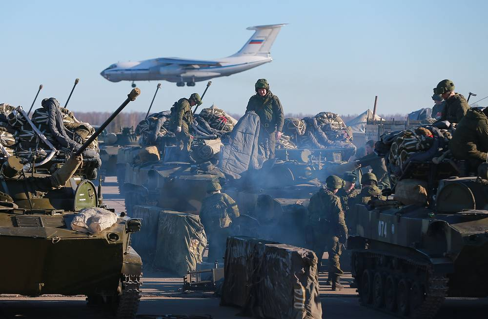 Military personnel prepare fighting vehicles BMD-2 for landing operation