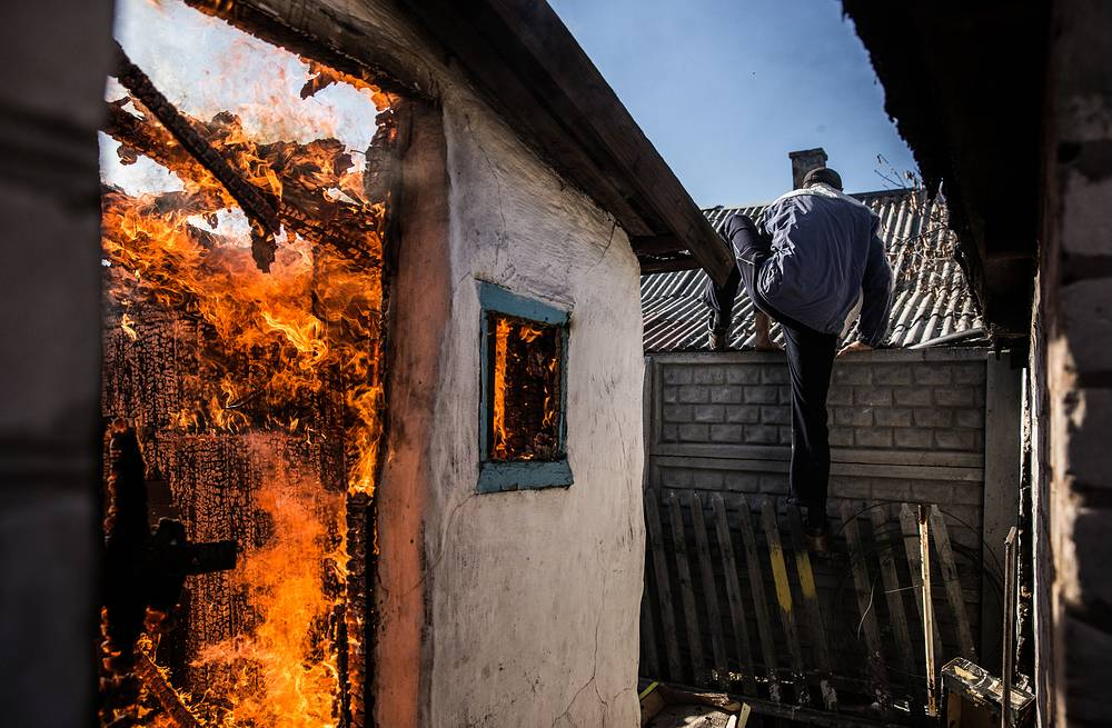 A house on fire in the aftermath of an overnight shelling attack by the Ukrainian government's troops, Donetsk region, November 2014