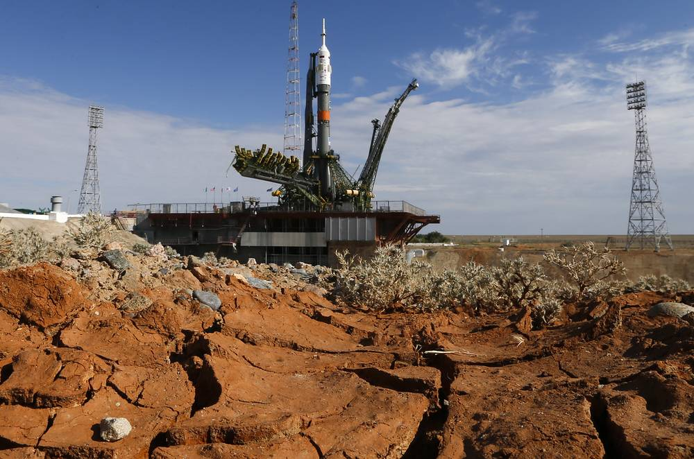 Soyuz FG rocket booster with the Soyuz TMA-17M spacecraft being installed on a launch pad at the Baikonur cosmodrome
