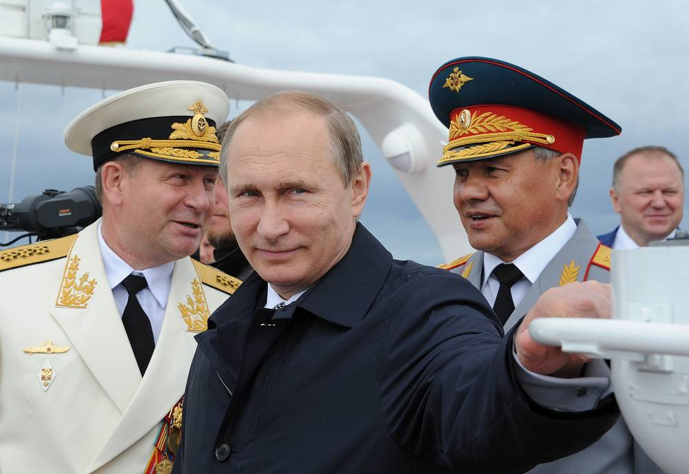 Commander-in-chief of the Russian Navy, Admiral Viktor Chirkov, Russia's President Vladimir Putin, and Russia's Defence Minister Sergei Shoigu at Russian Navy Day celebrations in Baltiysk