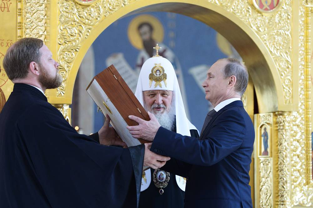 Patriarch Kirill of Moscow and all Russia and Russia's President Vladimir Putin visiting the renovated Church of St. Vladimir in the Old Gardens