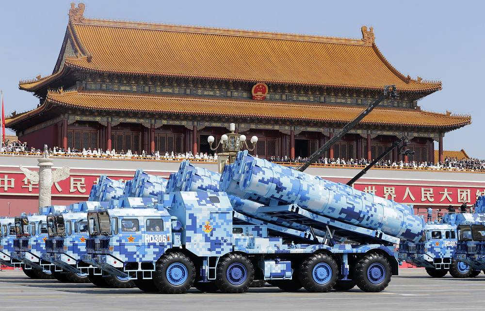 Military vehicles carry shore-to-ship missiles seen near the Tiananmen Gate
