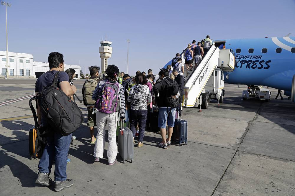 Passengers boarding an Egyptair Express plane bound for Cairo at Sharm el-Sheikh Airport, Egypt