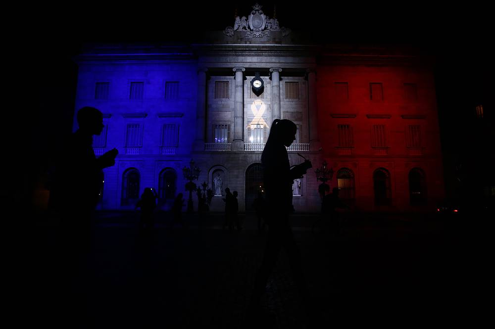 Town hall iluminated with the colors of the French tricolor in Barcelona, Spain
