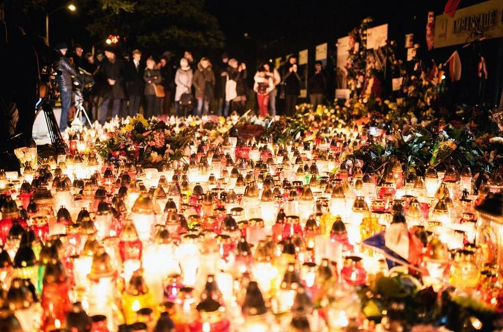Candles outside the French embassy in Warsaw, Poland