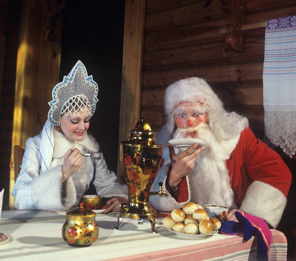 Grandfather Frost and Snow Maiden drinking tea, Altai region, 1980