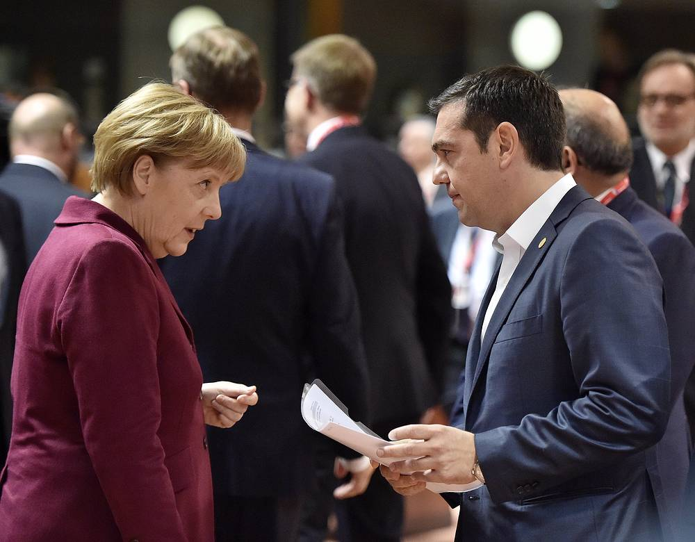 German Chancellor Angela Merkel talking with Greek Prime Minister Alexis Tsipras during the EU summit in Brussels, Belgium, October 15, 2015. European Union heads of state met to discuss migration crisis.