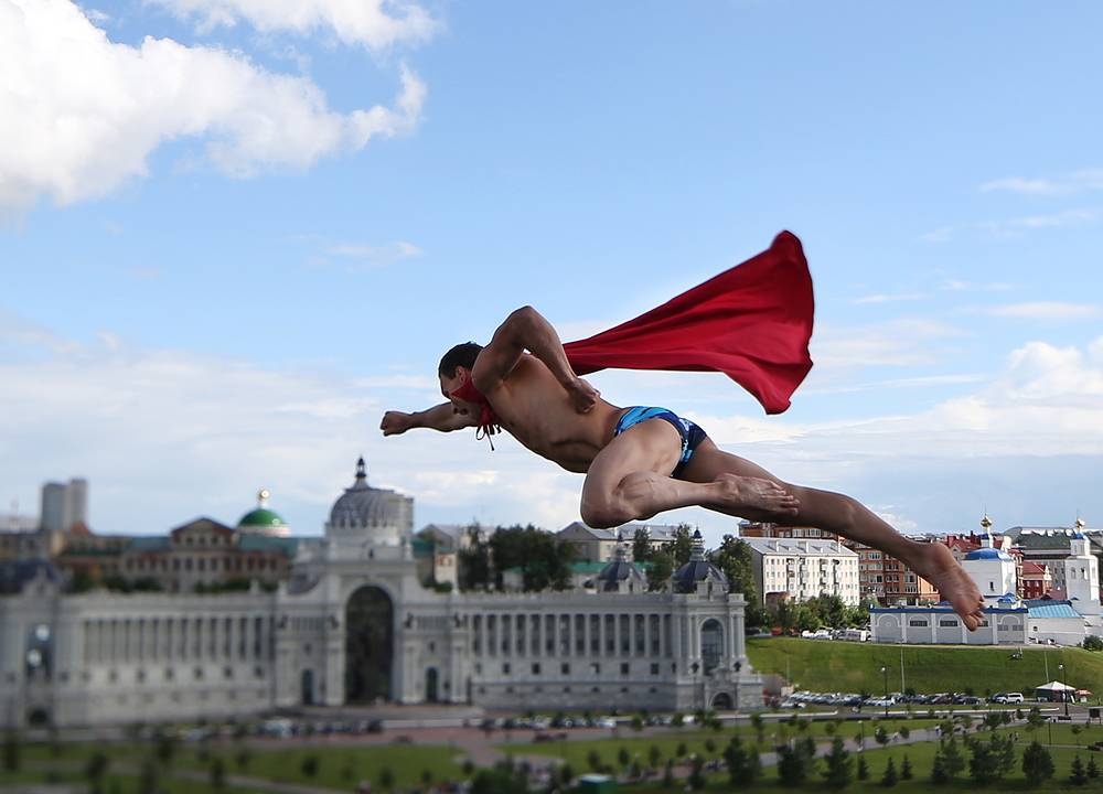 Michal Navratil of the Czech Republic dressed as Superman competing in the men's 27m high diving final at the 16th FINA World Championships, August 5, 2015