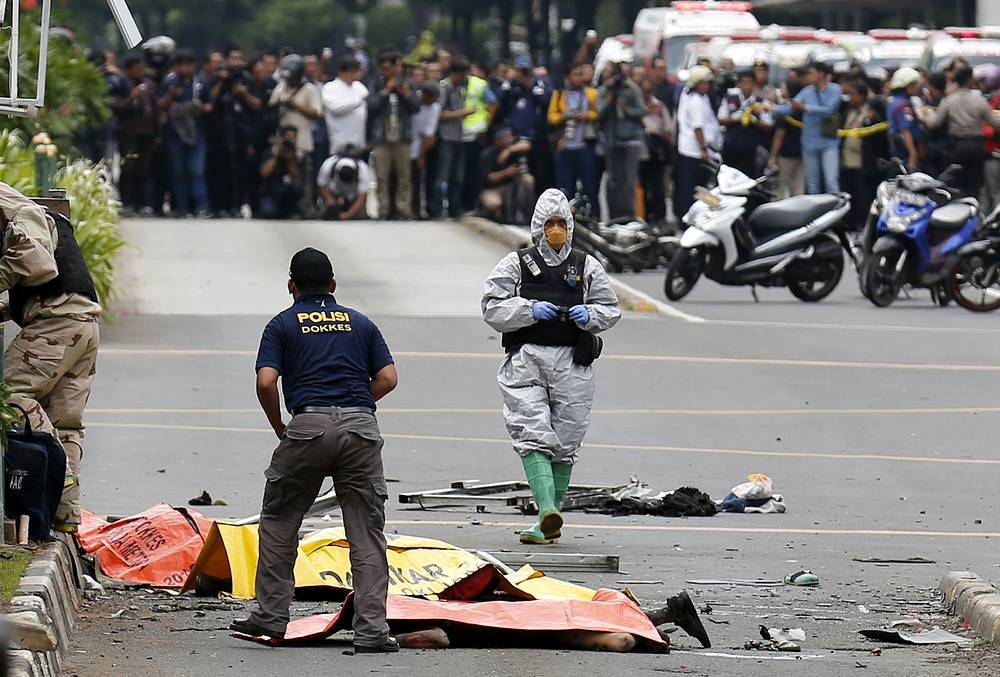 Members of the Indonesian police at the site of bomb blast in front of a shopping mall in Jakarta, Indonesia