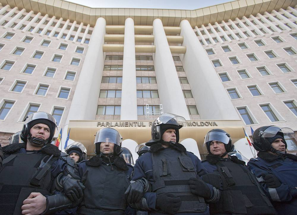 Police in front of the entrance to the parliament building during a protest in Chisinau