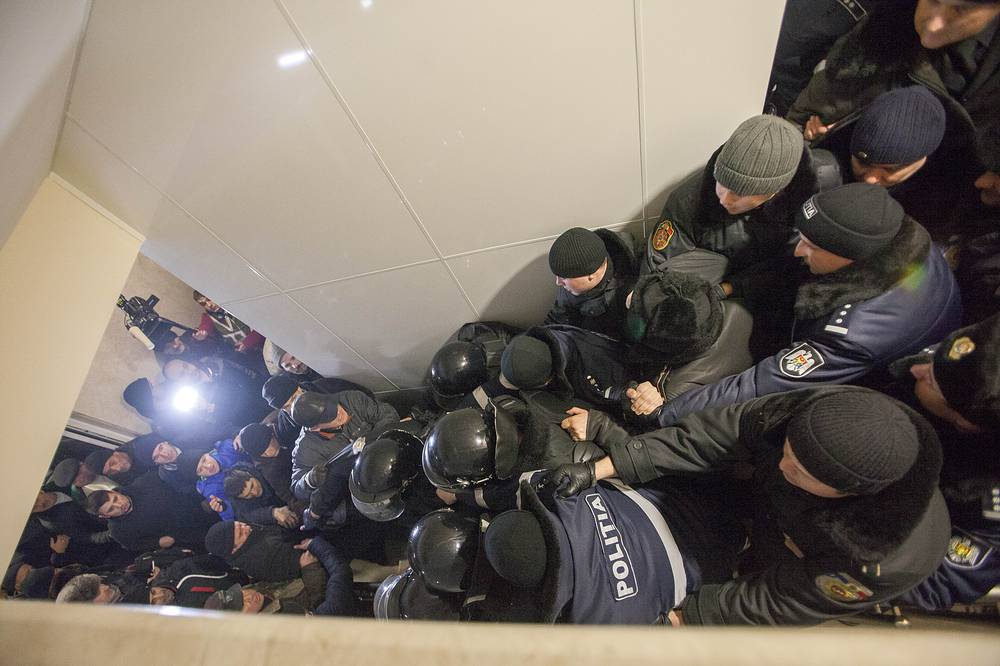Protesters pushing the police line inside of the Parliament building, during a protest against the election of democratic Pavel Filip as Prime Minister of Moldova, 20 January 2016