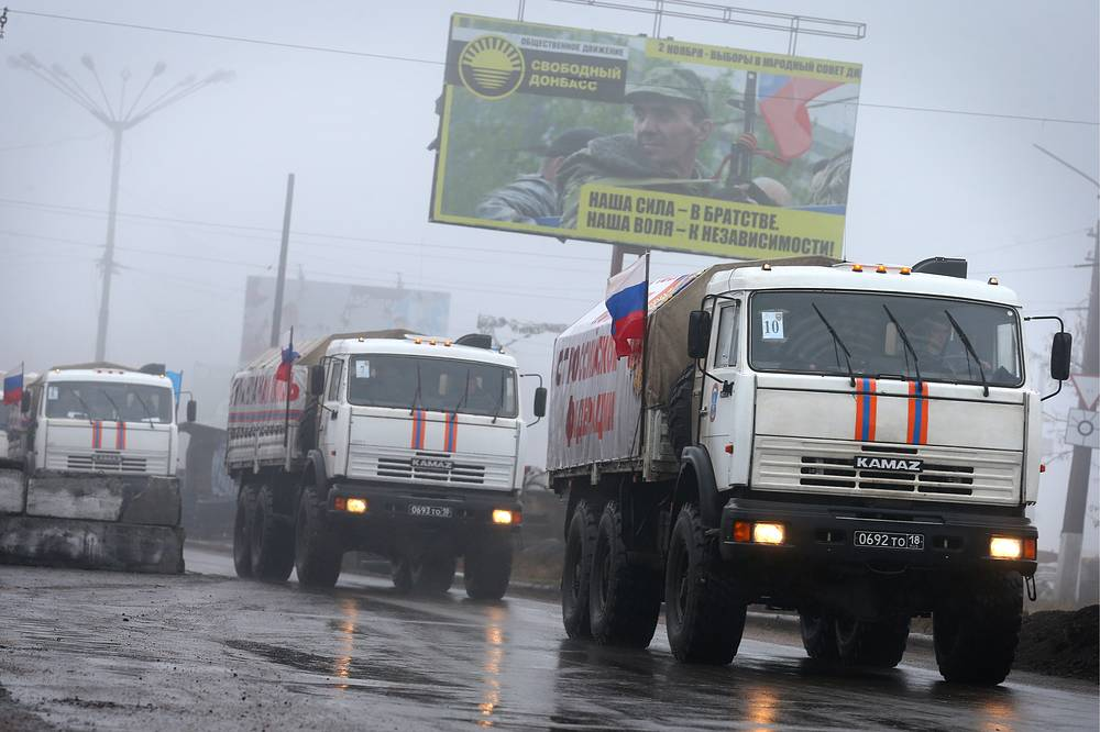 Trucks of Russia's humanitarian aid convoy arriving in the self-proclaimed Donetsk People's republic