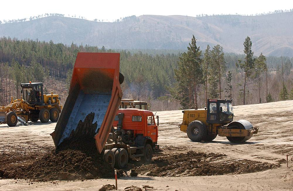Kamaz trucks at the construction site of the federal highway A-166 Chita-Zabaykalsk
