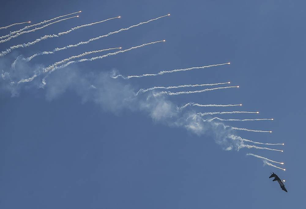 A Republic of Singapore Air Force F-15SG releasing flares during an aerial display at the Singapore Airshow