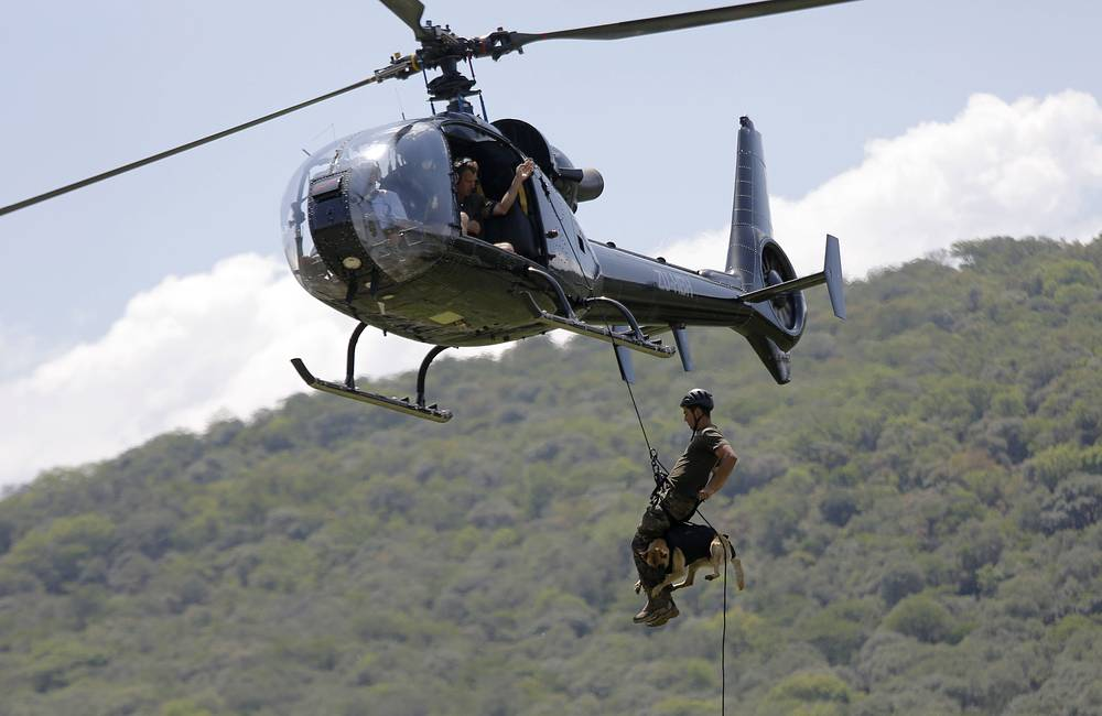 An dog handler with his dog taking part in an anti-poaching training exercise in Magaliesburg, South Africa