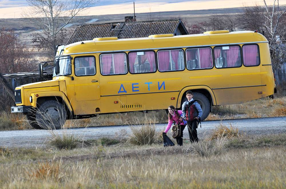 Students going to school bus in a village in Russia's Khakassia republic