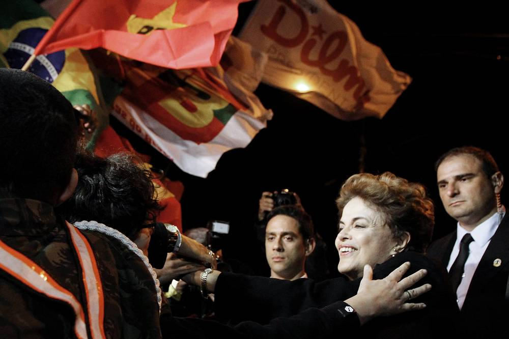 Ousted Brazilian President Dilma Rousseff greets her supporters at the Canoas Air Force Base in Porto Allegre, Brazil, September 6