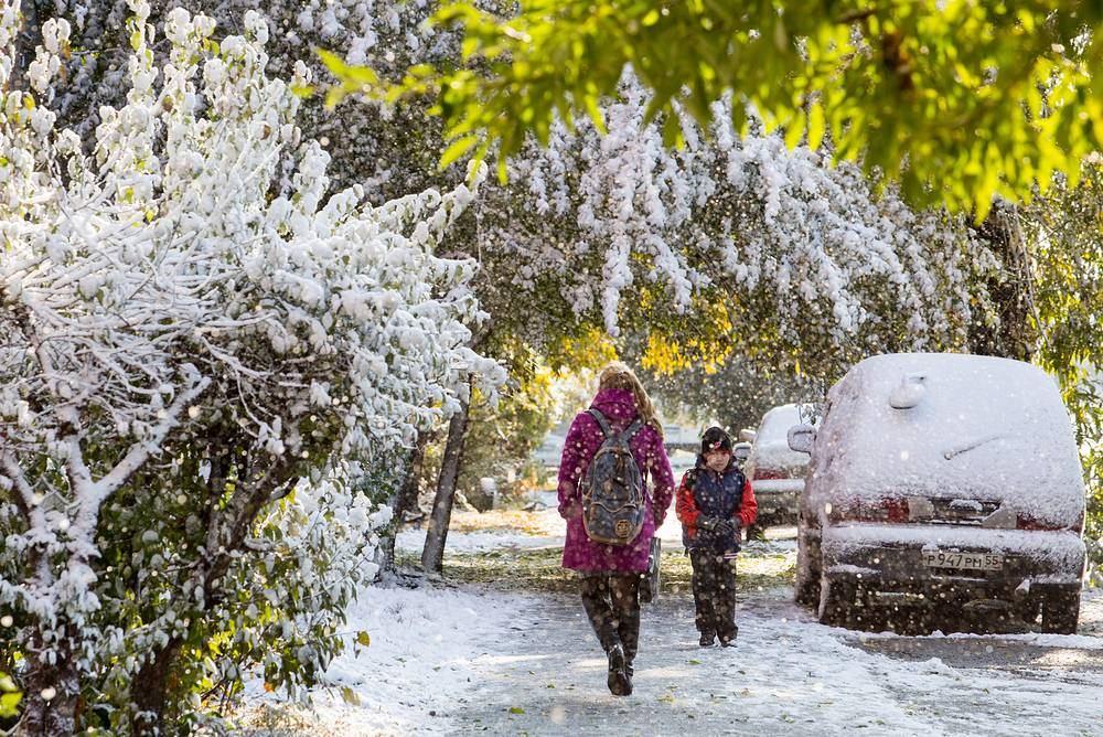 Trees covered in snow in the southern Siberian city of Omsk following an early snowfall, Russia, October 7