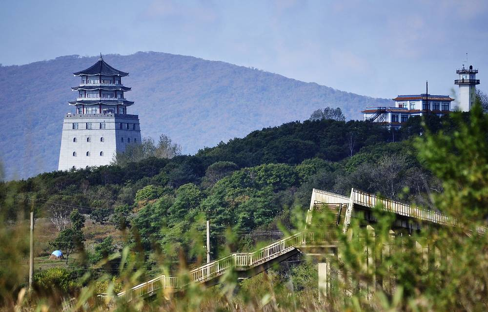 Chinese and North Korean watchtowers on the border of three countries - Russia, China and North Korea