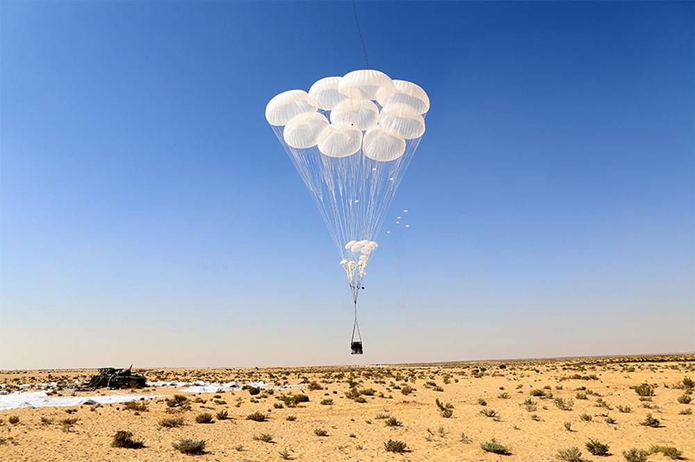 Ten military vehicles were parachuted