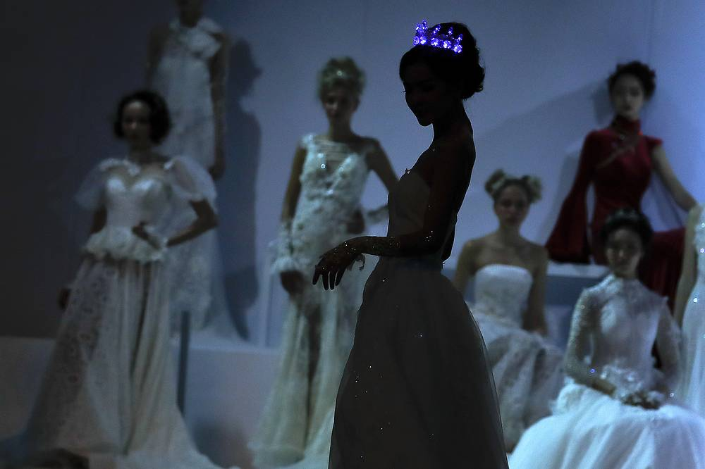 A model wears an illuminated crown during the Mercedes-Benz China Fashion Week in Beijing, China, October 27