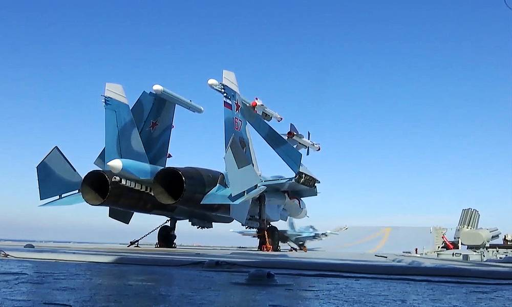 A Sukhoi Su-33 Russian fighter aircraft taking off from the deck of the Admiral Kuznetsov aircraft carrier