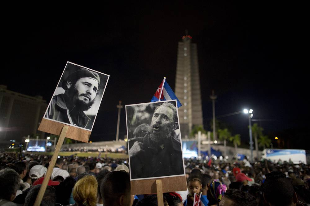 Participants hold portraits of Fidel Castro during a rally honoring the late Cuban leader at the Revolution Plaza in Havana, Cuba, November 29