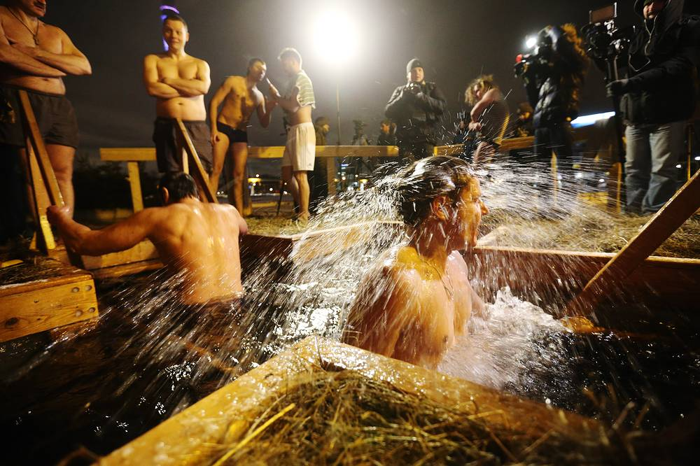 Orthodox believers dip in the icy waters of a pond in Ostankino Park in Moscow
